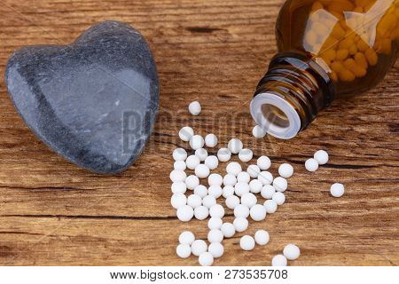 Homeopathy Medicine On Wooden Background.. Shot In Studio