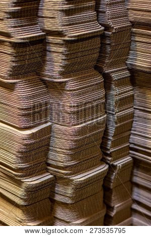 Corrugated Cardboard Boxes Flattened Stacked In Rows