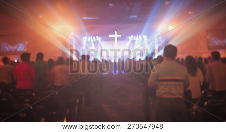 Christmas Concept: Blurred Christian Congregation Worship God Together In Church Hall In Front Of Mu