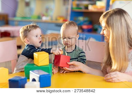 Cute Babies Play With Blocks. Educational Toys For Preschool And Kindergarten Child. Little Boys And