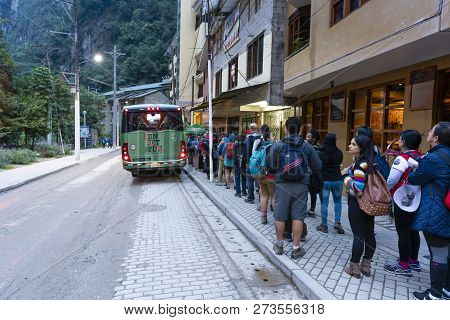 Aguas Calientes, Peru - Sep 14, 2018: Passengers Lining Up At A Terminal In Aguas Calientes For Bus