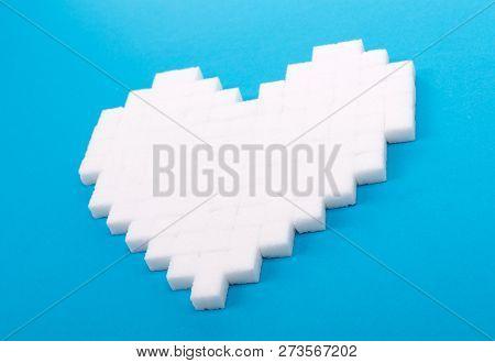 Diabetes Is Terrible Disease. Heart Of Sugar Cubes, Blue Background
