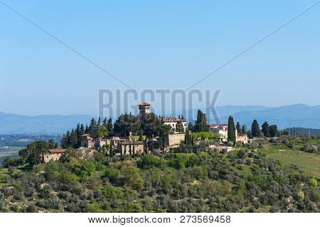 Beautiful tuscan landscape of a small rural town on the hill, Chianti, Italy. poster
