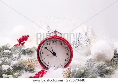 Red  Alarm Clock - Symbol Of  New Year, Fir Tree Branches, Berries, Balls  On White Fur Background.
