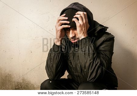 Homeless Man Drug And Alcohol Addict Sitting Alone And Depressed On The Street Feeling Anxious And L