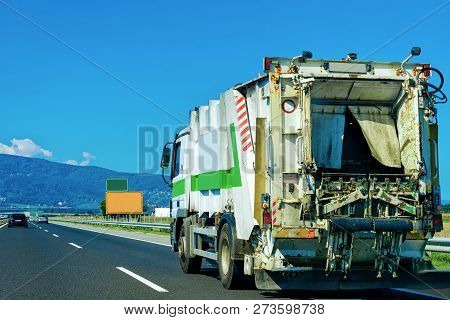 Truck Carrying Trailer With Garbage Container At The Asphalt Road In Slovenia.