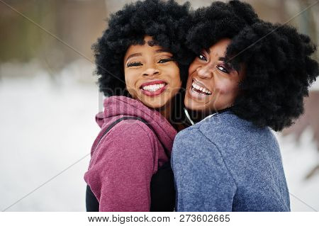 Two Curly Hair African American Woman Wear On Sweaters Posed At Winter Day.