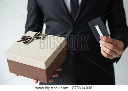 Close-up Of Businessman In Suit Buying Gift Card For Christmas Shopping. Unrecognizable Man Using Di