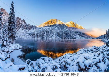 Mountains In Winter. Summit Illuminated With Sunshine. Stunning Winter Mountain Landscape With Clear