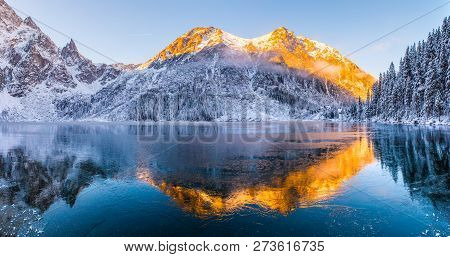 Winter Background. Winter Landscape With Mountains Reflected In Clear Frozen Lake. Sunny Frosty Morn