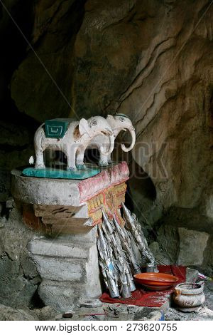 Two White Elephants On A Little Cave Shrine In Cambodia