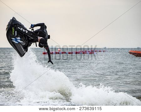 Jomtien Beach, Pattaya, Thailand - December 8, 2018 : The Young Man Man Drive Freestyle Jet Ski In T