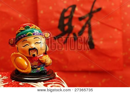 Traditional god of wealth with calligraphy