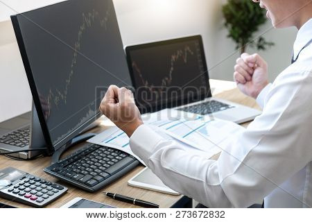 Businessman Trading Stocks Online, Stock Broker Looking At Graph Working And Analyzing With Display