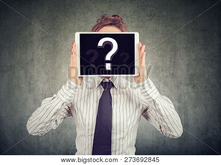 Anonymous Woman Covering Face With Tablet Showing Question Mark Hiding Personality In Internet