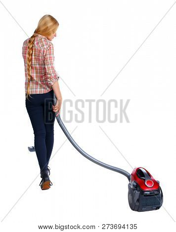 Rear view of a woman with a vacuum cleaner. She is busy cleaning. Rear view people collection.  backside view of person.  Isolated over white background. Long-haired blonde vacuums.