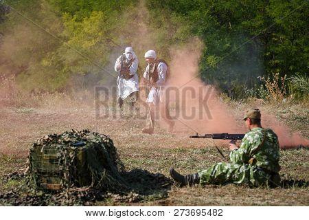 Sambek, Rostov Region, Russia, August 19, 2018: Reconstruction Of Afghan War. Mujahideen Attack The