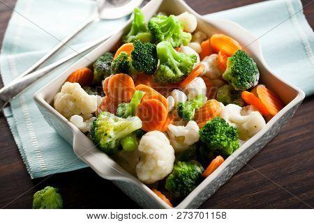 Fresh Frozen Vegetables On Wooden Background Close Up
