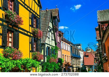 Traditional colorful half-timbered houses in Alsace. Riquewihr village, France