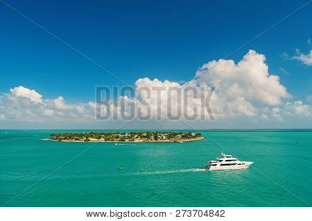 Cruise Touristic Boats Or Yachts Floating By Island With Houses And Green Trees On Turquoise Water A