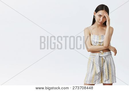 Girl came to elegant party with friend who humiliates her, feeling pissed and embarrassed, trying hide face with palm on forehead, staring with annoyed and bothered expression at camera poster