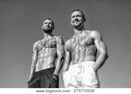 Guys Muscular Belly Posing. Sport And Bodycare. Muscular Masculine Guys Look Confident. Men Sexy Mus