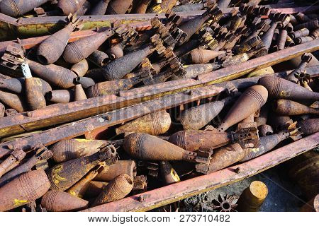 Closeup Of Disarmed War Salvage, Rusty Munitions, Shell Casings, Bombs, Bombies, Unexploded Ordnance