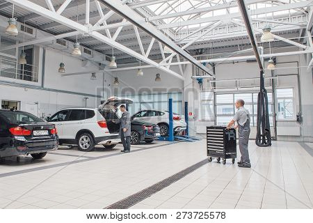 Car Repair, Bmw Advertising, Moscow, 1.11.2018: Bmw Motor Company Badge On The Front From A Black Ca