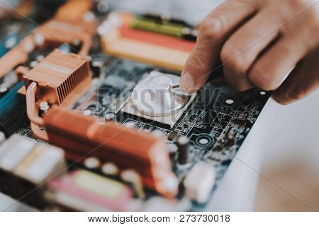 Close Up. Computer Doctor In White Uniform With Stethoscope. Man With Motherboard. Examination Of Di