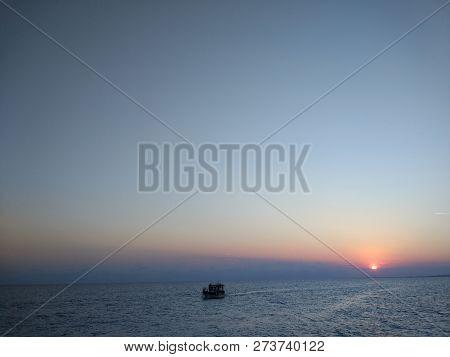 A beautiful sunny sunset on the beach on a sunny day