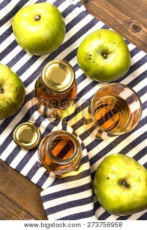Home Made Apple Juice From An Old British Apple Variety, Bramley In A Glass And Bottle