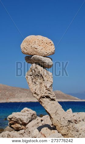 A tower of stones on Ftenagia beach at Emborio on the Greek island of Halki.
