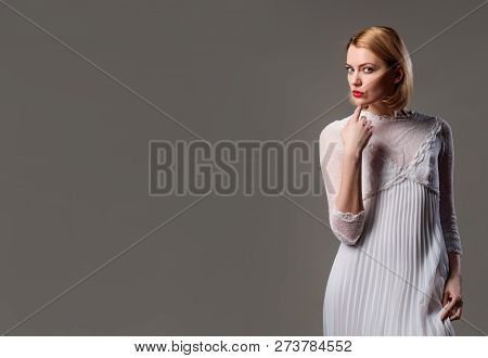 Beautiful Girl With Blonde Hair, Perfect Makeup. Girl In Elegant White Dress. Elegant Dress Concept.