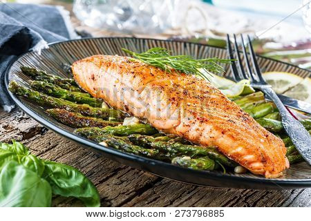 Grilled Salmon And Asparagus On Wooden Table Close Up