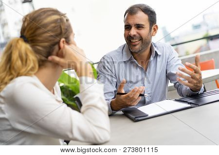 Business Team Discussing Startup. Financial Consultant Talking To Female Client And Laughing. Busine