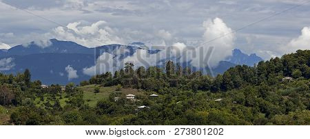 View Of The Mountains With Sky And Clouds Above Them.