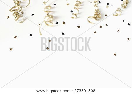 Happy New Year Or Birthday Festive Composition. Golden Confetti And Glittering Stars On White Table
