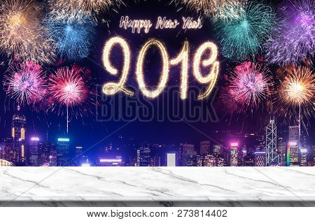 Happy New Year 2019 Fireworks Over Cityscape At Night With Empty White Marlbe Table,banner Mock Up T