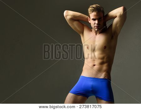 Attractive Brutal Man In Blue Panties. Handsome Sexy Sporty Man. Shirtless Man With Athletic Body In