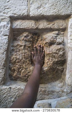 Jerusalem, Israel. Touching The Holy Stone On The Via Dolorosa. Imprint Of Jesus Hand.