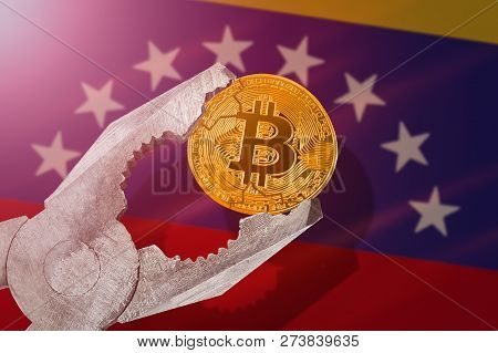Bitcoin (btc) Coin Being Squeezed In Vice On Venezuela Flag Background; Concept Of Cryptocurrency Bi