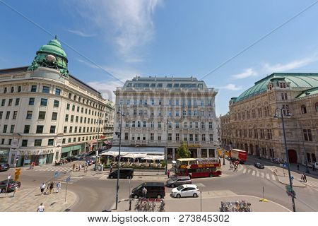 VIENNA, AUSTRIA - JULY 2018 : People, vehicle in front of cafe, hotel, state opera, on Albertina in the Innere Stadt (First District) of Vienna, Austria on July 17, 2018.