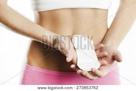 Women Period Product. Closeup Of Beautiful Fit Slim Female Body In White Underwear Holding Sanitary