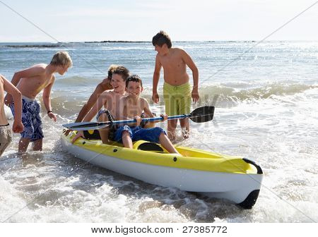 Teenage boys kayaking