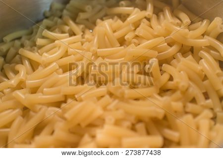 Macaroni Noodles In A Metal Cooking Pot.