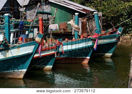Ribbons Decorating The Bows (front) Of Wooden Green And White Fishing Boats In Asia
