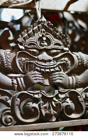 Cambodian Wooden Carving Of A Cheeky Demon At A Market