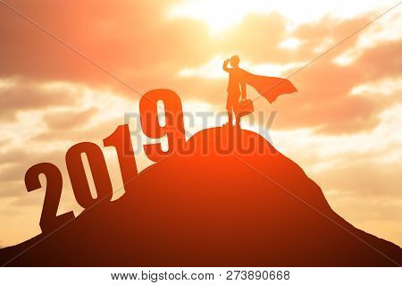 Silhouette Of Super Business Man Look Somewhere With 2019 On The Mountain
