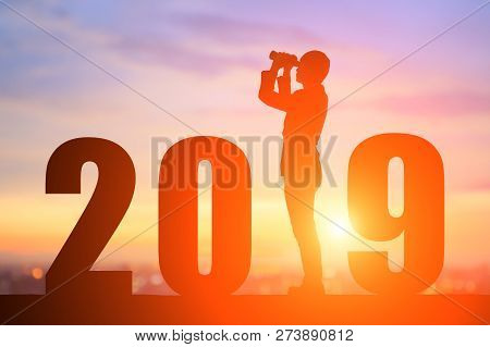Silhouette Of Business Man Look Through Binoculars With 2019