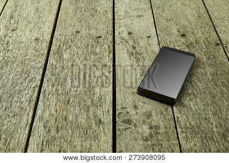 Top View Image Of Smart Phone With Trading On Old Wooden Table For Stock Trading And Business Financ